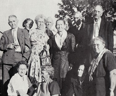 "Jack ""Papa"" Stephens, back row, second from right; Oliver Stephens, back row, far right; Onie Stephens Jones, front row, far right; Emma Shelburn Stephens Glover, front row, second from right; Della Shelburn Stephens Champlin, in center with scarf; Nora Stephens Horton, front row, second from left © Pryor Center for Arkansas Oral and Visual History, University of Arkansas"